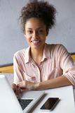 Young african american woman working on laptop Royalty Free Stock Photos