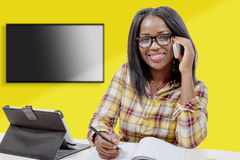 Young african american woman writing, and giving a call with mob Royalty Free Stock Photography