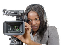 Young African American women with professional video camera and. A young African American woman with professional video camera and headphone Royalty Free Stock Photography