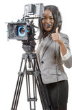 Young African American women with professional video camera and Royalty Free Stock Images