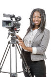 Young African American women with professional video camera and. A young African American woman with professional video camera and headphone Royalty Free Stock Images