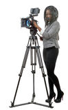 Young African American women with professional video camera and. A young African American woman with professional video camera and headphone Royalty Free Stock Photos