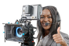 Young African American women with professional video camera. A young African American woman with professional video camera and headphone Stock Image