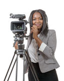 Young African American women with professional video camera. A young African American woman with professional video camera and headphone Stock Images