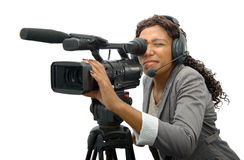Young African American women with professional video camera. A young African American woman with professional video camera and headphone Royalty Free Stock Photography