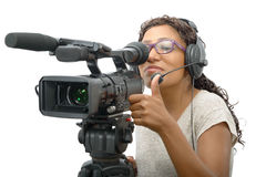 Young African American women with professional video camera. A young African American woman with professional video camera and headphone Royalty Free Stock Photo