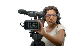 Young African American women with professional video camera. A young African American woman with professional video camera and headphone Royalty Free Stock Images