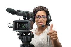 Young African American women with professional video camera. A young African American woman with professional video camera and headphone on white Stock Images