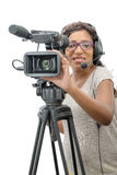 Young African American women with professional video camera. A young African American woman with professional video camera and headphone on white Royalty Free Stock Images