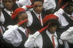 Young African-American women salute stock photos