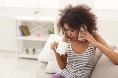Young woman at home talking on mobile phone stock photo