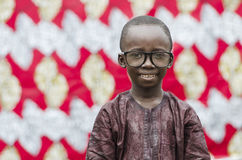 Young african boy in eyeglasses looking at camera. African boy with big black glasses Royalty Free Stock Photography