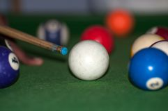 A young African boy playing billiard. A player is targeting the ball in the Tanzania stock images