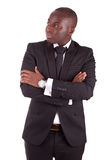 Young african business man with folded arms. Isolated on white background Royalty Free Stock Images