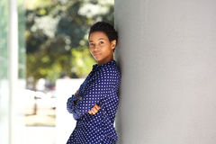 Young african business woman leaning against wall Royalty Free Stock Photography