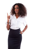 Young african business woman showing something. Young african american business woman showing something, isolated over white background Royalty Free Stock Photo