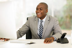 Young african businessman working on computer Royalty Free Stock Images
