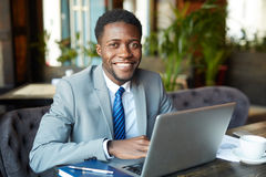 Young African Businessman Working with Laptop Royalty Free Stock Images
