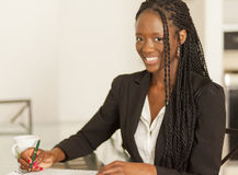 Young african businesswoman. Smiling Young African Student Woman At Home Royalty Free Stock Images