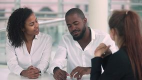 African couple happy to rent buy new house handshake realtor. Young african couple giving high five happy to rent buy new house, black customers first time home stock footage