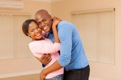 young african couple hugging Stock Image