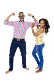 Young African Couple Showing Off Their Muscles Stock Photography