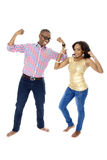 Young African Couple Showing Off Their Muscles Royalty Free Stock Photo
