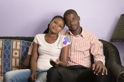 Young african couple on sofa Stock Image