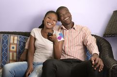Young african couple on sofa Royalty Free Stock Photography