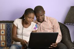 Young african couple surfing the internet Royalty Free Stock Images
