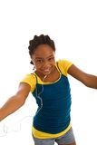 Young African descent young lady dancing Royalty Free Stock Photography