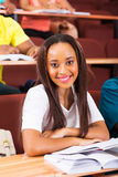 Young african female student in class. Beautiful young african female student in class looking at the camera stock images