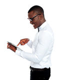 Young african geek using electronic device Royalty Free Stock Image