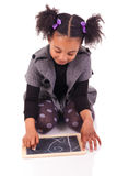 Young African girl with a black slate Stock Photos