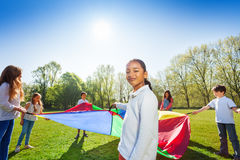 Young African girl playing parachute with friends Royalty Free Stock Photo