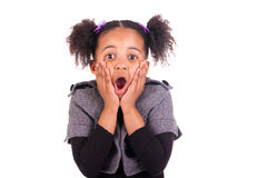 young African girl surprised, isolated on white ba Stock Photos
