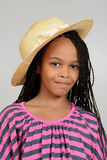 Young african girl wearing a straw hat Royalty Free Stock Images