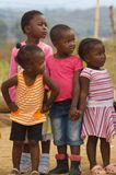 Young African girls. In a township looking at what is going on over there Stock Photography