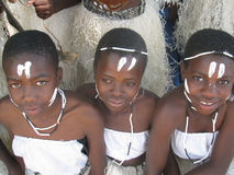 Young  African  girls  in traditional  dressing and  facemarks. Royalty Free Stock Image
