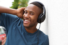 Young african guy listening to music on headphones Royalty Free Stock Images