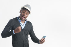 Young african guy looking at cell phone Stock Images