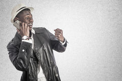 Young african guy looking at cell phone stock photos