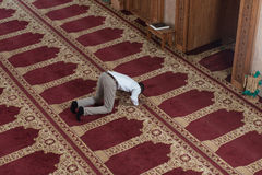 Young African Guy Praying In Mosque Royalty Free Stock Image