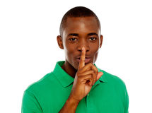 Young african guy showing silence gesture Stock Photo