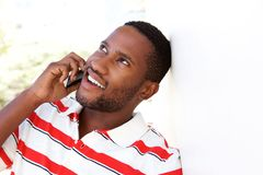 Young african guy talking on mobile phone Stock Photo