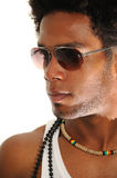 Young african male model. Portrait of young trendy african american man posing with sunglasses royalty free stock image