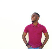 Young african male model smiling against white background. Portrait of young african male model smiling against white background Stock Images