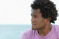 Young african man on the beach Royalty Free Stock Image