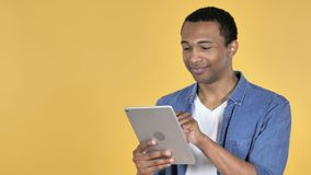 Young African Man Browsing Internet, Using Tablet. 4k high quality, 4k high quality stock video footage