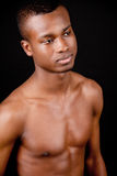 Young african man with dark skin looking Royalty Free Stock Photography